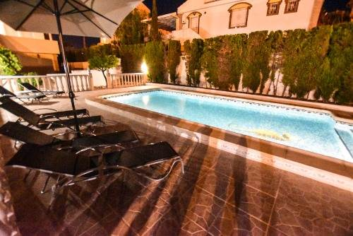 The Pool & Gardens At Night