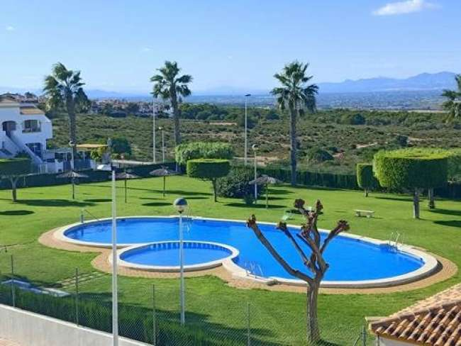 Modern and fully air-conditioned 2 bed apartment with large roof terrace and free WiFi opposite communal pool